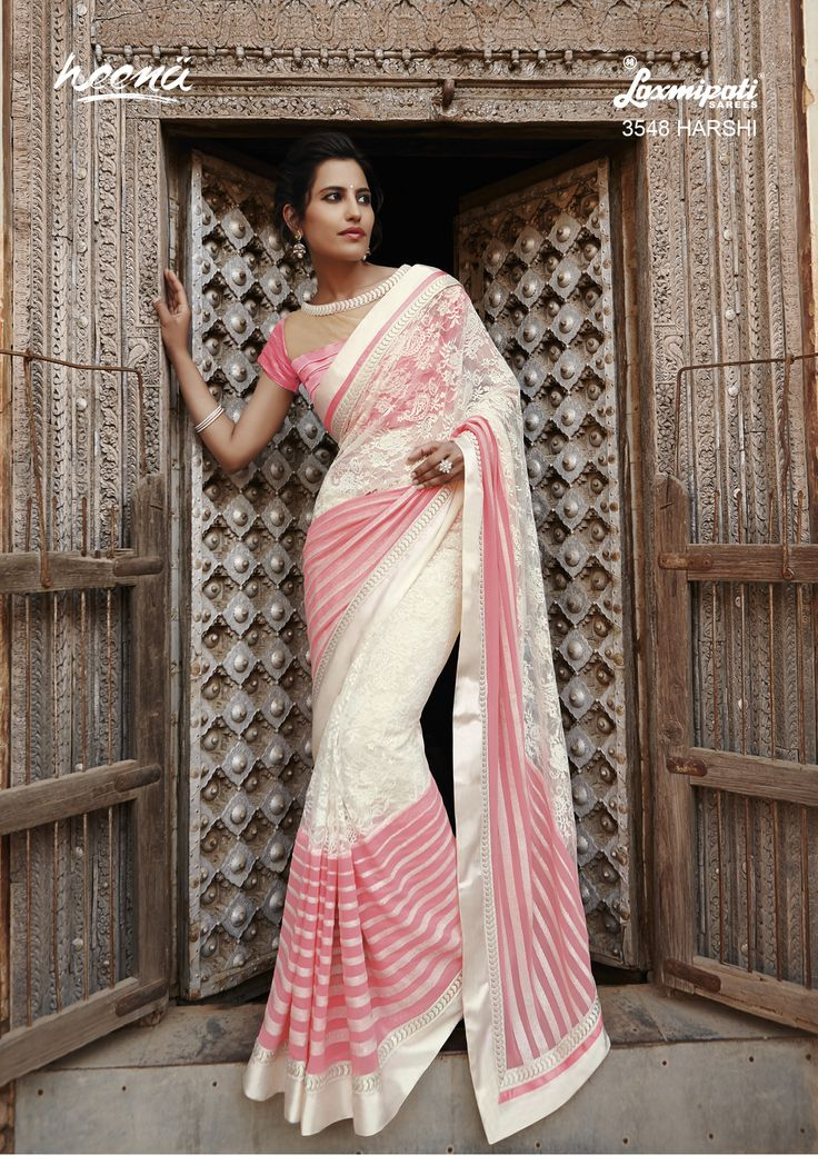 Magnificent Offwhite Pink saree as jacquard net on the top and Stripe sequence work on gerogette in the bottom improvised with bordered resham jari work and rawsilk jacquard net blouse.