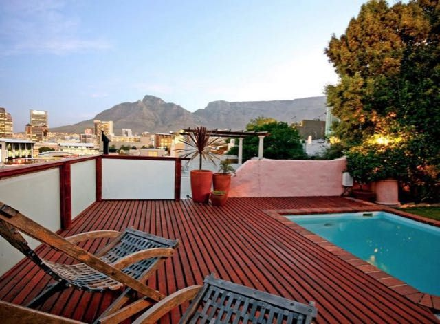 Cape Lights in Cape Town (Sleeps 4) . This trendy self-catering apartment has spectacular views of the V & A Waterfront, City and Table Mountain from its own private wooden deck and balcony. #CapeTown #DeWaterkant