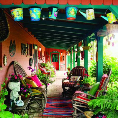 South-of-the-border style patio. Willow chairs invite lounging on this large front porch, which doubles as a gallery for a festive collection of Mexican artifacts