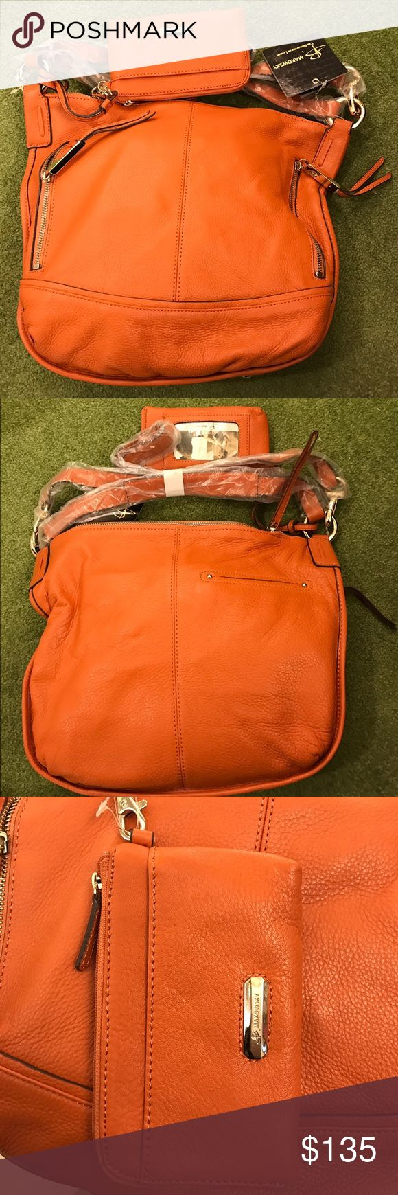 Brand New B. Makowsky Orange Leather Handbag This is a brand new B. Makowsky handbag with matching wallet. The bag is 13.5 inches wide  x 13 inches height. The smaller strap is 14inches long and the cross body strap is 34 inches long. The wallet is 6 inches wide x 4 inches height. It has a zipper compartment, Id pocket and a another little front pocket. The handbag as 2 functioning zipper pockets in the front, cell phone pocket inside the bag, another zipper pocket inside and a small pocket…