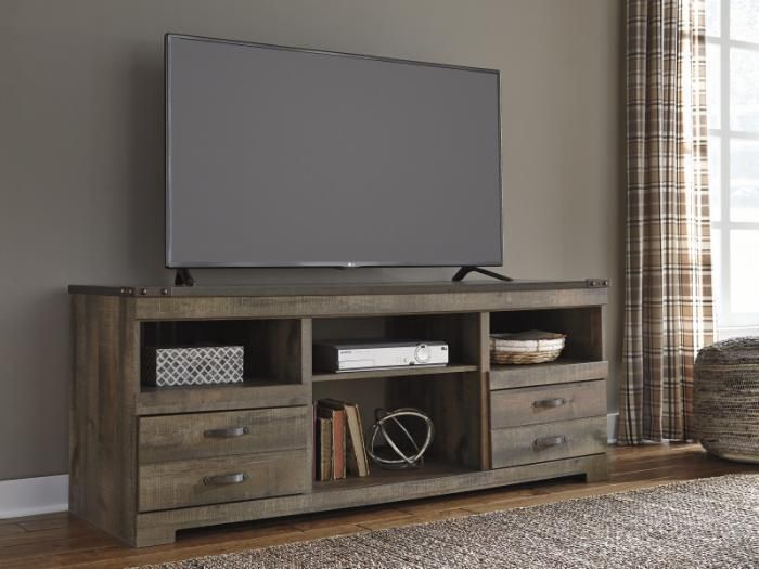 "Add vintage flair to your living space with the HE28 Vintage Brown 65"" TV Stand. This television stand can accommodate up to 65"" TVs and is designed in a worn brown finish for a rustic look. The drawers offer hidden storage space, while the shelves allow you to put your favorite accessories on display."