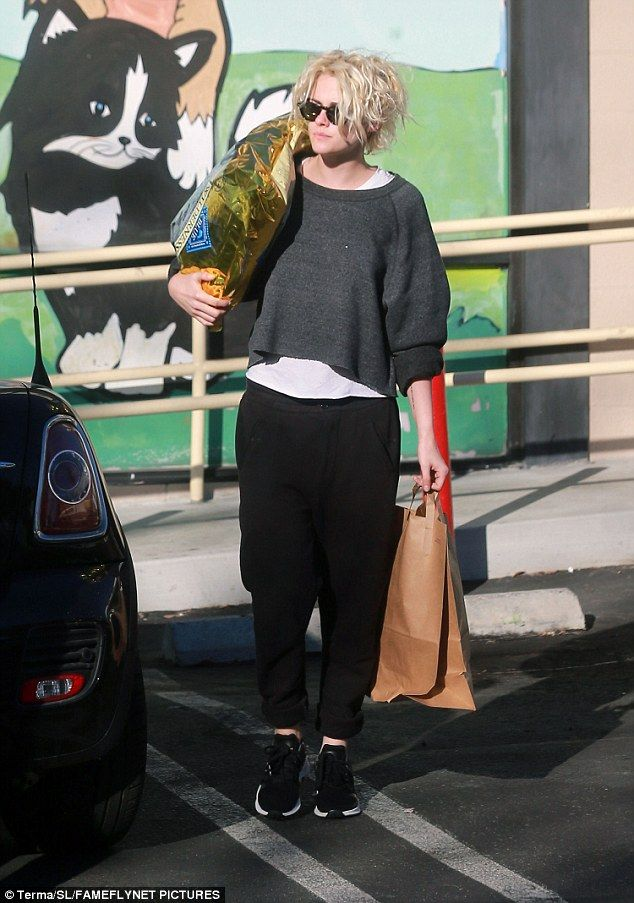 Low key: For the doggy food date, the pair both dressed casually with the Personal Shopper actress wearing black tapered sweatpants with a white T-shirt and a loose-fit cropped sweater