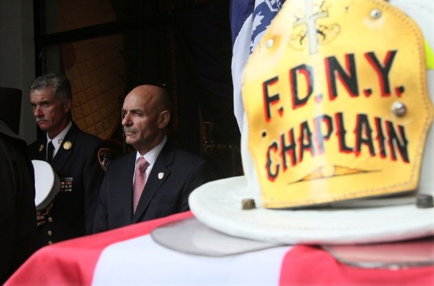 FDNY Chief of Department Edward Kilduff, left, and City of New York Fire Commissioner Salvatore J. Cassano take part in a memorial ceremony for the 343 members of the FDNY who lost their lives in the World Trade Center attacks 10 years ago as the helmet worn by FDNY Chaplain Mychal Judge on 9/11 sits on view Sunday Sept. 11, 2011 at the New York City Fire Museum in New York. The helmet and bunker coat worn by Father Judge on 9/11, when he lost his life, were dedicated to the museum during…