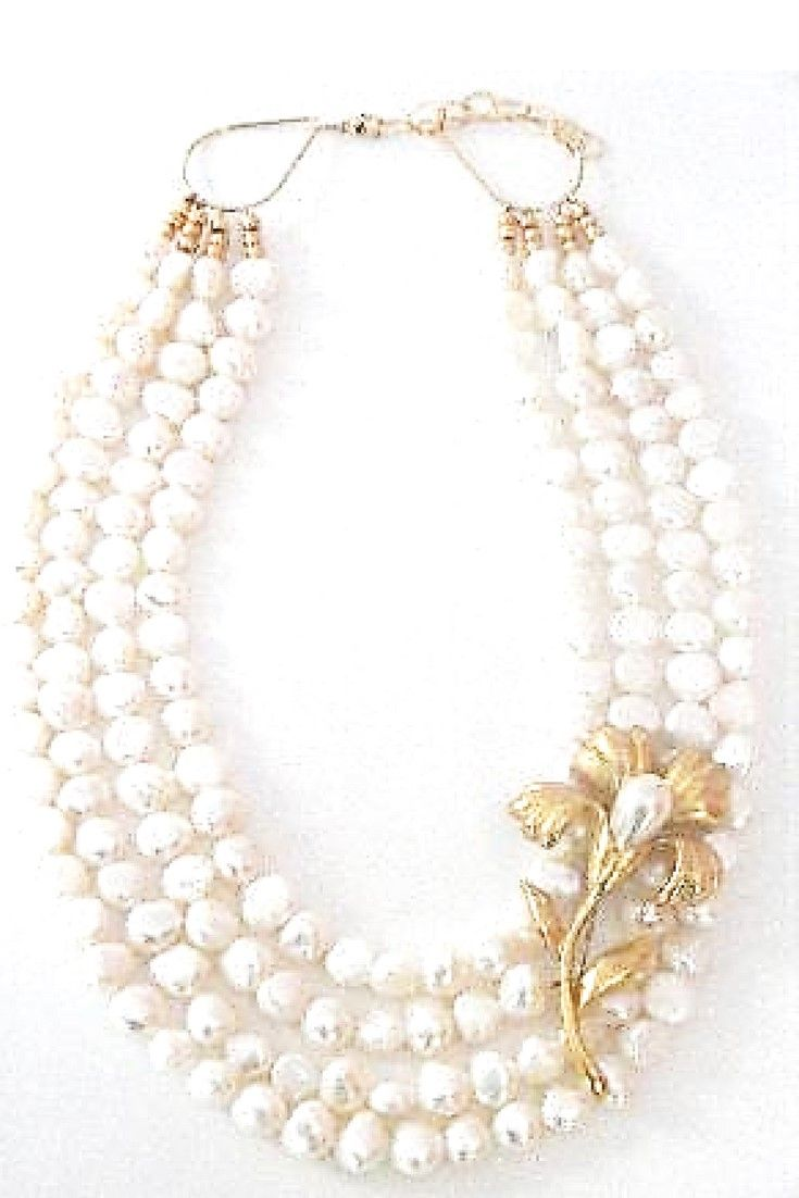 White freshwater pearl & Vintage Flower brooch necklace.  One-of-a-kind statement necklace handmade with white freshwater pearls paired with vintage brooch $265,00. #handmadenecklace #freshwaterpearl#statementnecklaces#necklaces