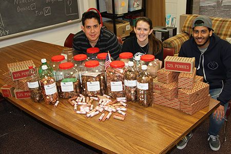 A grand total of 110,000 pennies was collected collected for Alex's Lemonade Stand for children's cancer research -- that's $1,100! Pictured are Anthony Borek, SGA Public Relations representative, Nicole McIntire, Student Activities events coordinator, and Jun Del Valle, SGA senator.