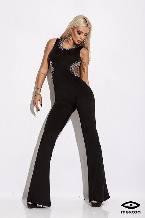021641061cdf Tuta elegante di colore nero con pantalone a zampa.