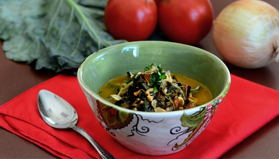 Ifisashi recipe from Zambia: Hot rice casserole served in a thick, buttery peanut sauce. Collard greens and tomatoes add a garden-fresh flavor to this creamy dish.