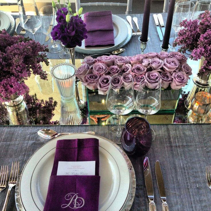 Love this table by Colin Cowie. The shades of purple and gray are elegant and sophisticated. The varying flowers keep it interesting, and the mirrors add sparkle and depth without overdoing it. (From Colin Cowie Weddings)
