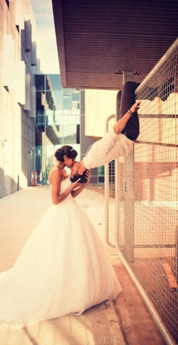 Spiderman kiss. such a cute wedding photo <3  ...I love the idea of a superhero-inspired wedding