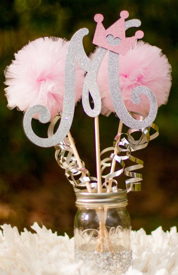 ***Please note that current processing time is up to 2 weeks plus shipping time. Larger orders will have a longer processing time. If you need an item sooner please message me BEFORE placing the order.***    This listing is for a custom princess centerpiece. Please note letter at checkout. You will receive: 1 Letter stick made from glittery silver card stock and adorned with a pink tiara (please note letter at checkout) 2 pink pom pom sticks with silver ribbon 1 silver glittery mason jar (1…