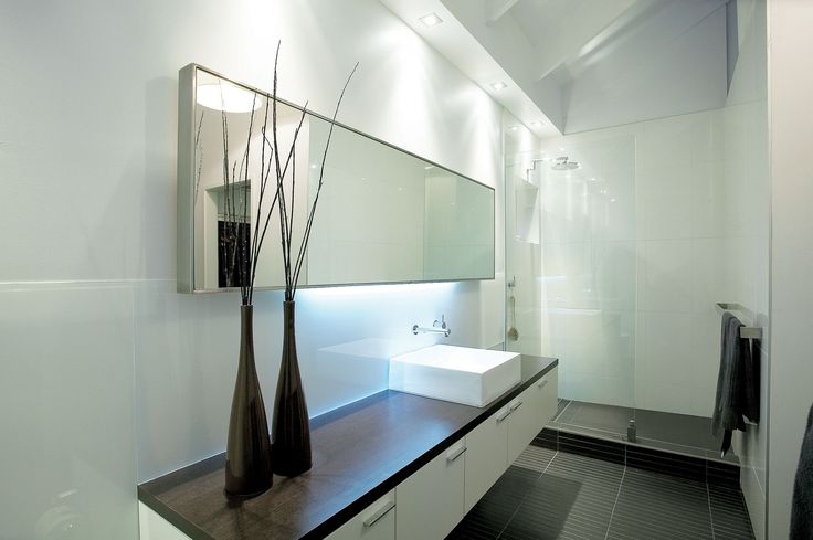 Design & Staging Danni Brown | Sundowner Court | Ensuite Bathroom | Stainless Steel framed mirror | Walk in shower | Cabinetry | Concealed lighting | Chocolate pencil tiles