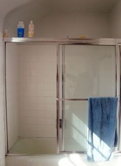 similar door (current) How To Replace Shower Doors with a Shower Curtain — Apartment Therapy Tutorials