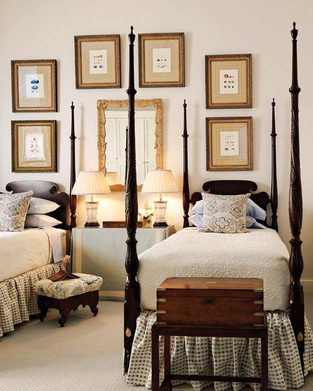 Traditional twin beds in a bedroom that looks fresh and updated.