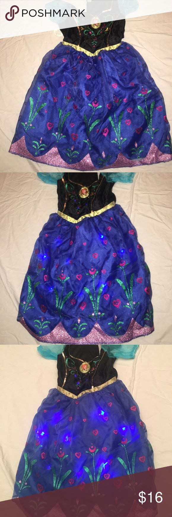Frozen ana costume dress, sings and lights up Frozens Ana dress, sings For the First Time in Forever (don't worry you can turn it off) and whole skirt lights up with blue leds. worn once , great for dress up or halloween Disney Costumes