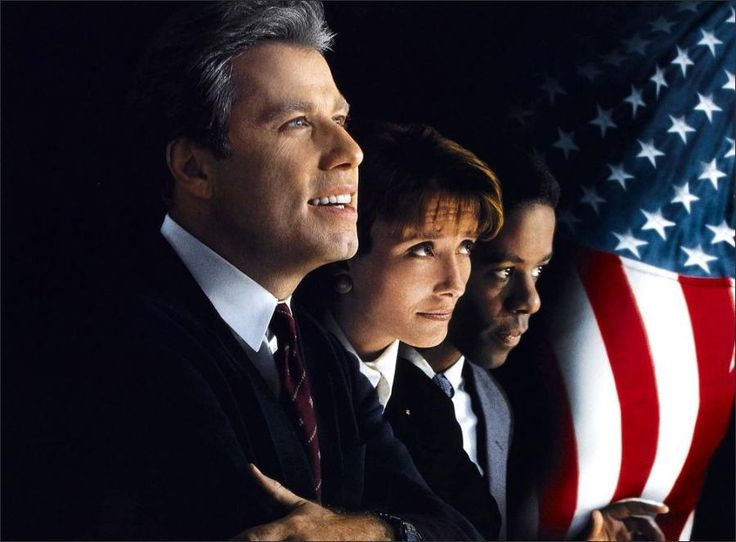 """Mike Nichols directed this Elaine May screenplay adapted from the 1996 bestseller by """"Anonymous"""" (Joe Klein), who fictionalized Bill Clinton's first presidential campaign. In the New Hampshire primary, Governor Jack Stanton (John Travolta) convinces Henry Burton (Adrian Lester), grandson of a respected civil rights pioneer, to become his deputy campaign manager. Stanton's smart wife Susan (Emma Thompson) always comes through with public support for her philandering husband."""