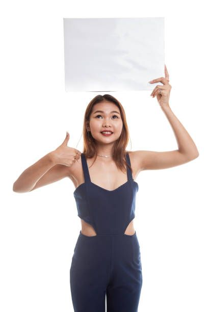 young asian woman show thumbs up with white blank sign