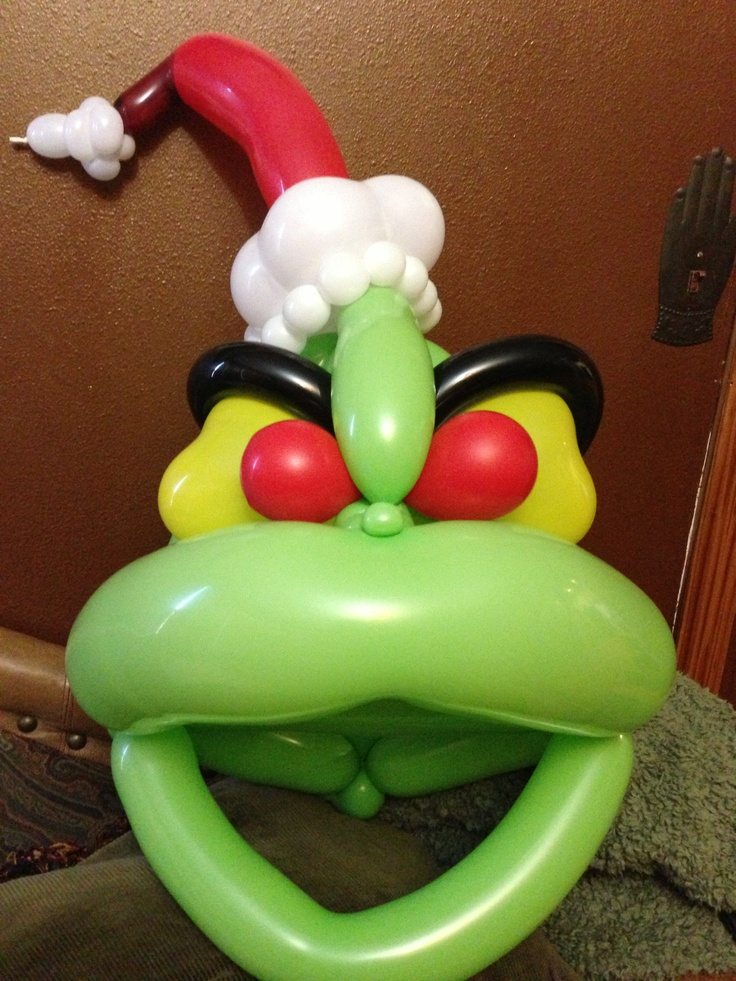 A Grinch animal balloon mask made by Denver balloon twister, Savannah the Balloon Twister!