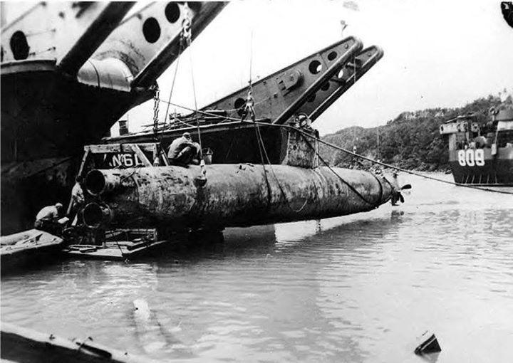 US Navy salvaging a Japanese Type A Ko-hyoteki midget submarine from shallows around Okinawa Japan 1945.