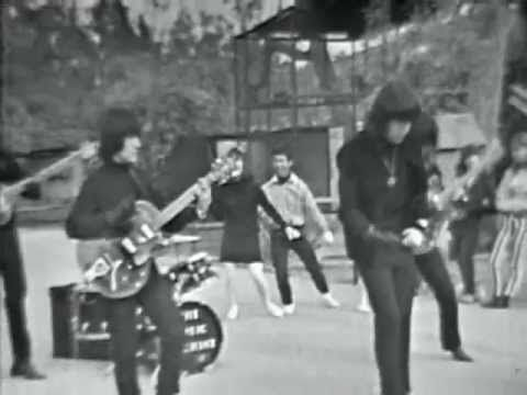 "Been looking for this (even if it is lip-synced on some lame TV show)!  Music Machine - ""Talk Talk.""  One of the most interesting of '60s garage rockers.  Dig the single black glove on their right hands."