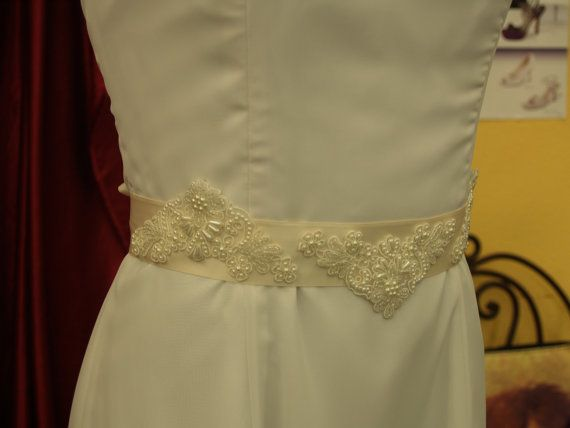 Bridal Gown Sash Ivory three appliqués by NewBrideCo on Etsy, $69.00  I love the beading on this. Don't know if we could contact to shop to see if they could make something like this in the size and shape you want