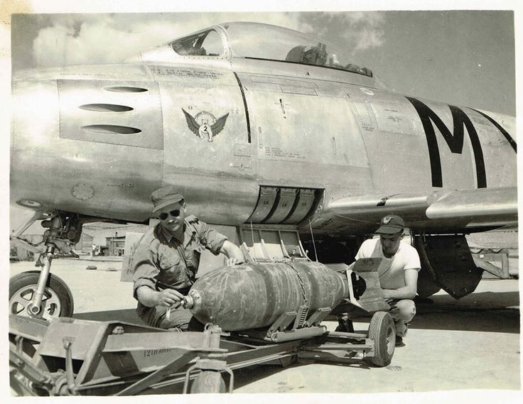 South African Air Force 2 Squadron Armourers Air Sergeant Steyn and Leading Air Mechanic Britz Fuzing Bombs prior to a mission over North Korea - Sabre