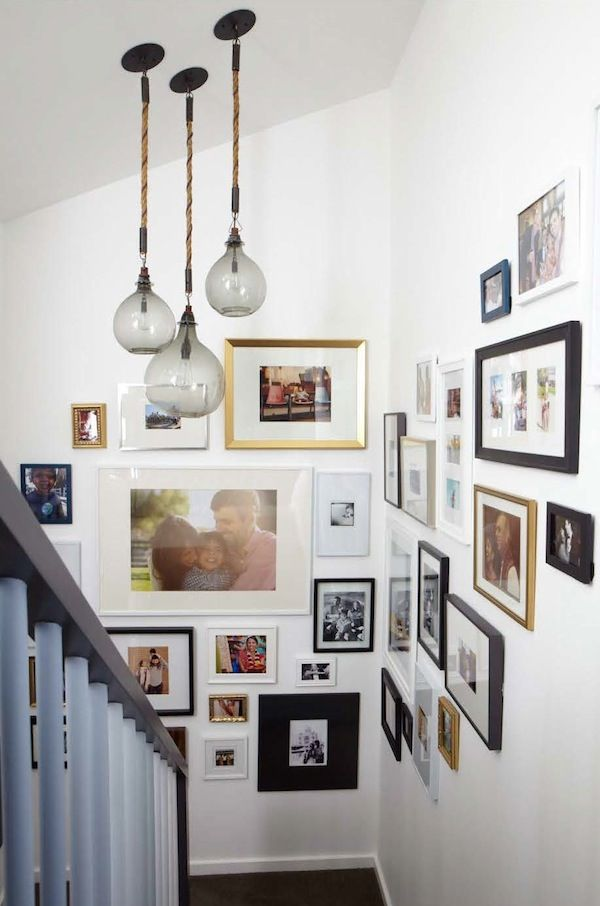 Love the idea of a gallery art wall on the stairwell. Such a great feeling walking up and down the stairs each day. :)