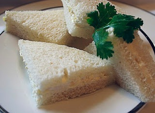 Pineapple cream cheese finger sandwiches except add coconut and ham. Had it for the first time today & beyond OBSESSED!