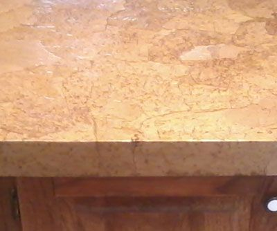 Closeup after decoupaged countertop is dry. Looks like stone...brown marble
