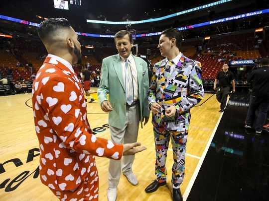 """I wasn't even alive when he started wearing his jackets like this"", Sean Baum said of Craig Sager. He and friend Moody Hammed(left) dressed in bright suits at the Miami Heat game to honor Sager. They are big fans of his. Sager admires the outfits when the guys asked for a photo with him. He worked the Chicago Bulls at Miami Heat game on Thursday, April 7, 2016.  (Photo: Andrea Melendez/The News-Press)"