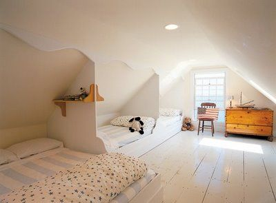 built-in beds in attic space (Rob Whitten, architect); simple architectural detail using mdf or plywood; beds are boxed and set low to the floor; walls, floors, ceilings painted same color to give illusion of light. Another great option for sleeping a family in one room.