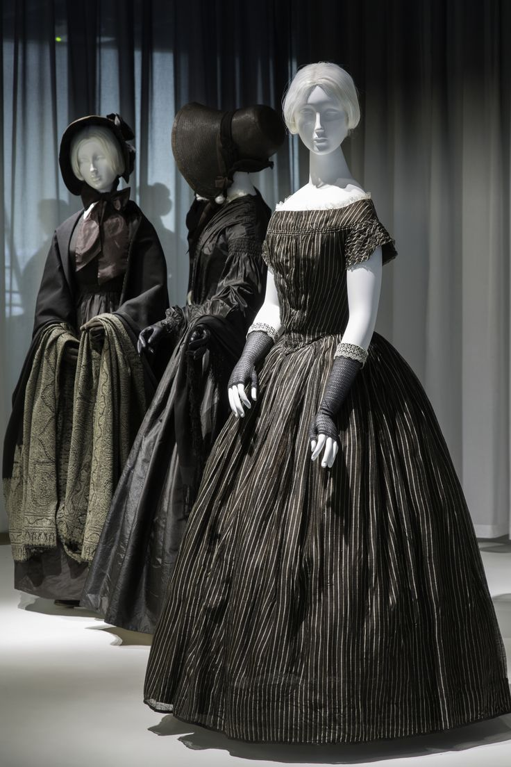 "#DeathBecomesHer Gallery View. | The exhibition ""Death Becomes Her: A Century of Mourning Attire,"" on view through February 1, 2015, explores the aesthetic development and cultural implications of mourning fashions of the nineteenth and early twentieth centuries. Approximately thirty ensembles, many of which are being exhibited for the first time, reveal the impact of high-fashion standards on the sartorial dictates of bereavement rituals as they evolved over a century."