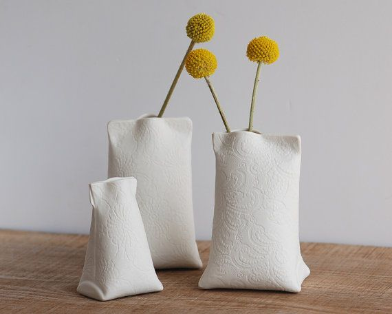 love these porcelain 'pouch' vases