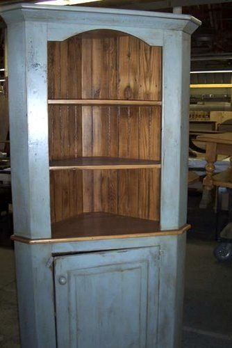 Corner hutch.  I like this look for the corner nx to the patio door.