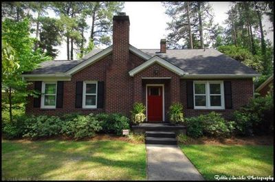 BRICK bungalow offers HARDWOODS, GRANITE kitchen w/STAINLESS appliances, CUSTOM cabinets & trim, recent WINDOWS, ELECTRIC PANEL, ROOF, & HVAC. Master offers DUAL closets/ WALK-IN with BUILT-INs, CUSTOM TILED/granite bath. Bonus space- OFFICE/Work room & Mudroom/Laundry! Great room w/ GAS log fireplace opens to kitchen. Private backyard with storage SHED conveys. Termite bond. Minutes to downtown, shopping/dining amenities.