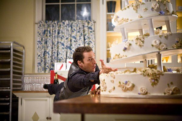Matthew McConaughey with a wedding cake in Ghosts of Girlfriends Past.