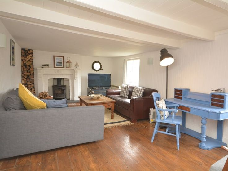 Spacious lounge on the middle floor with woodburner