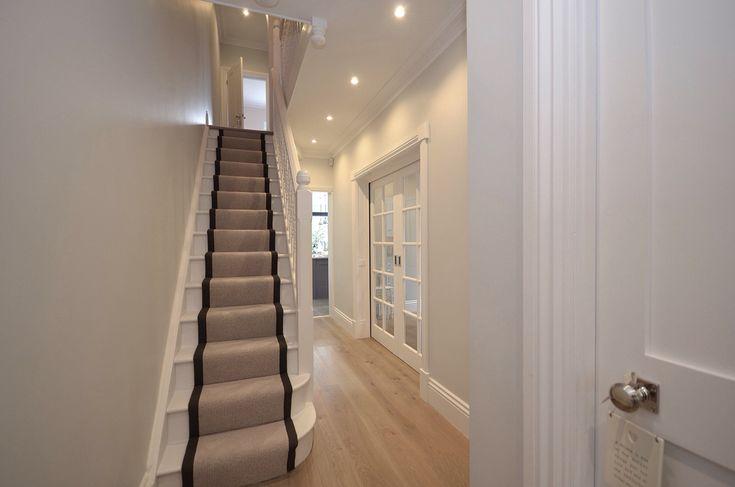 Edwardian halls-adjoining semi, hallway with leather-edged stair runner, Champagne Oak flooring, sliding pocket door to dining room, shaker white door. Walls in Farrow & Ball - Blackened