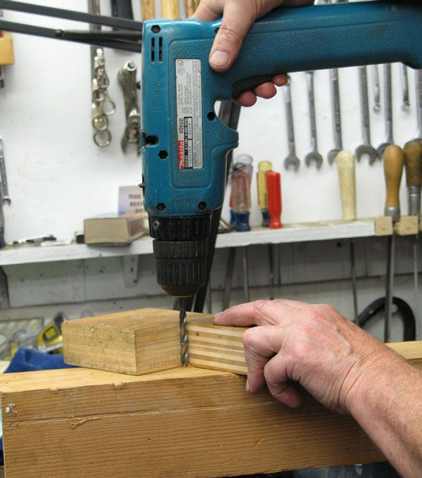 Drill Guide by Frank Ford -- Homemade drill guide fabricated from a thick block of wood. Features an alignment notch to serve as a reference for perpendicularity in two axes. http://www.homemadetools.net/homemade-drill-guide