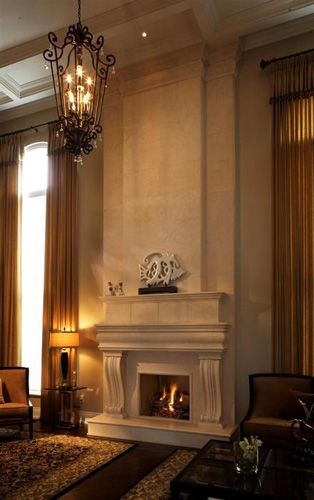 The Claire cast stone fireplace mantel and overmantel bring elegance to this room. Prices start at $1894. http://www.mantelsdirect.com/cast_stone/classic_series/claire-stone-fireplace-mantel.html