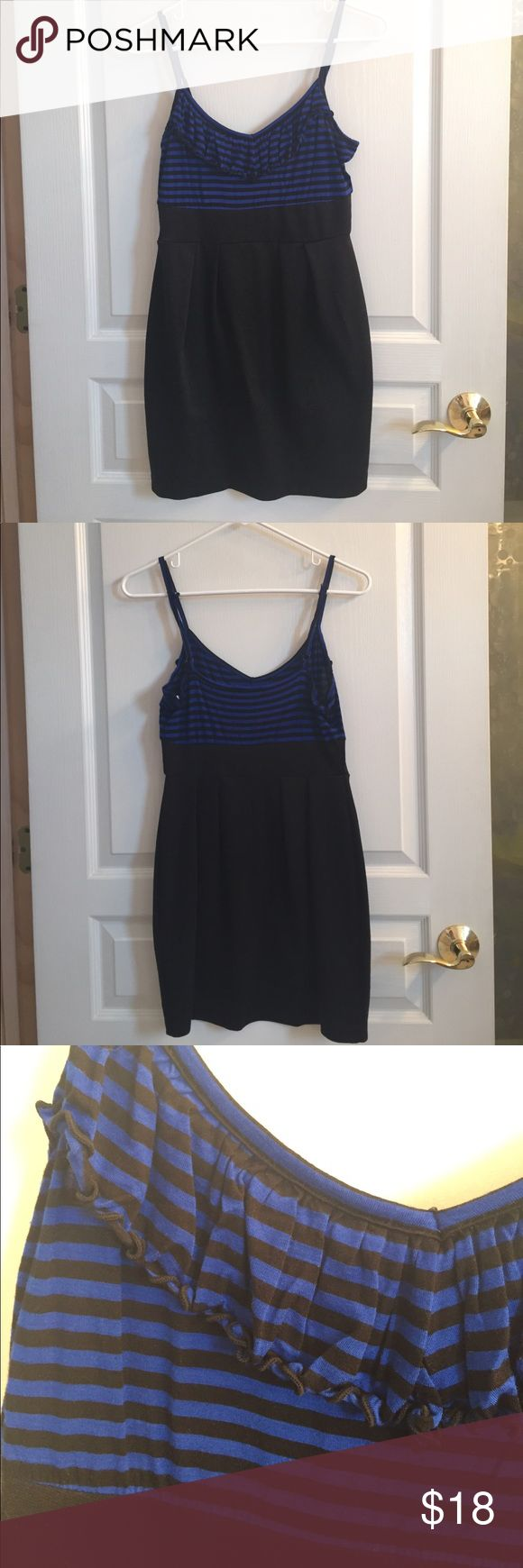 Cute mini going out dress! Very comfortable 👌🏽 This dress is adorable with the black and blue striped top with ruffle, and flattering skirt below. Very comfortable material, you'll have a great time in this cute piece! In perfect condition! The straps are adjustable 👍🏽 If you have any questions, please ask. Feel free to make an offer. Thanks :) Forever 21 Dresses Mini