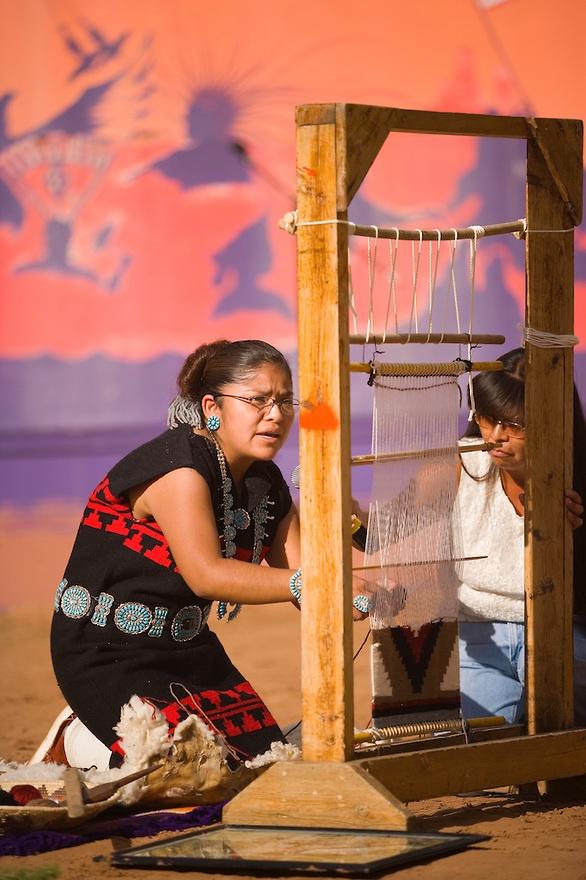 Navajo Indian woman demonstrates rug weaving