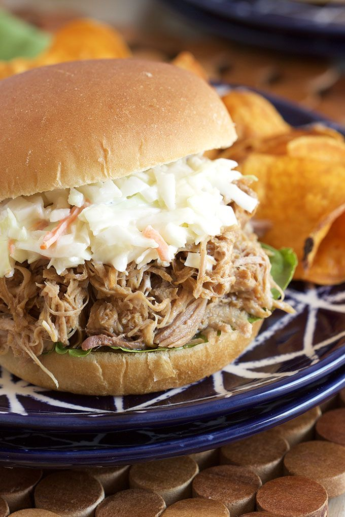 This Slow Cooker Pulled Pork recipe is packed with sweet, smokey flavor and is perfect for super bowl parties, tailgating or easy weeknight dinners. Crock-pot perfection! | @suburbansoapbox