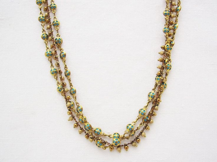 """Three strands turquoise beads and brass combine in a necklace both classic and bohemian. / Gold plated over copper, 16"""" long with a 2"""" extender.  La Vie Parisienne by Catherine Popesco  $58.00    Lewis and Clark -Antiques and Fine Things, Santa Barbara, CA (http://www.lewisandclarkltd.com)"""