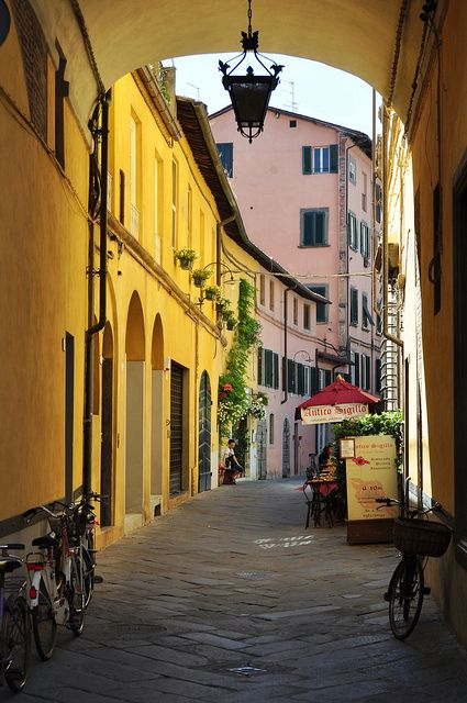 A street in Lucca, Tuscany Region, Italy. Lucca is situated on the river Serchio in a fertile plain near the Tyrrhenian Sea. It is famous among other things for its intact Renaissance-era city walls.