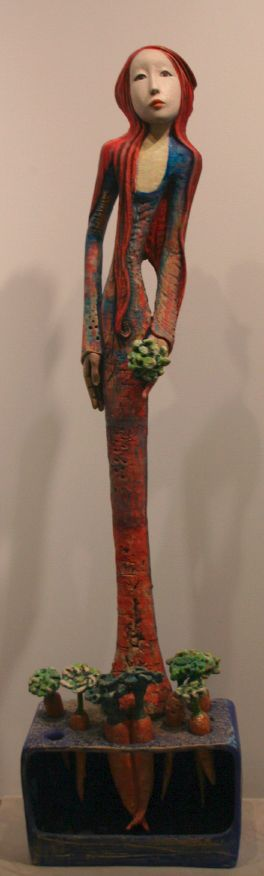 "This is not a doll-doll. But the magic is there....Camille VandenBerge. ""Little Carrot Gardener"". Sculpture."