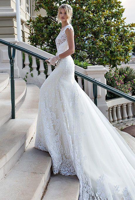 Alessandra Rinaudo Bridal Couture. Ivory sheath beaded lace dress with a long train.