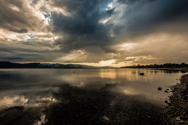 Trixonida lake near Agrinio city. After the rain... Enjoy the view of the sun coming out of the clouds...