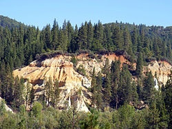 """Malakoff Diggins is the site of California's largest hydraulic mines. It is a 26 mile drive north-east of Nevada City, California in the Gold Rush country.  The """"canyon"""" is 7,000 feet long, as much as 3,000 feet wide, and nearly 600 feet deep in places. Visitors can see huge cliffs carved by mighty streams of water, results of the hydraulic mining technique of washing away entire mountains of gravel to wash out the gold."""