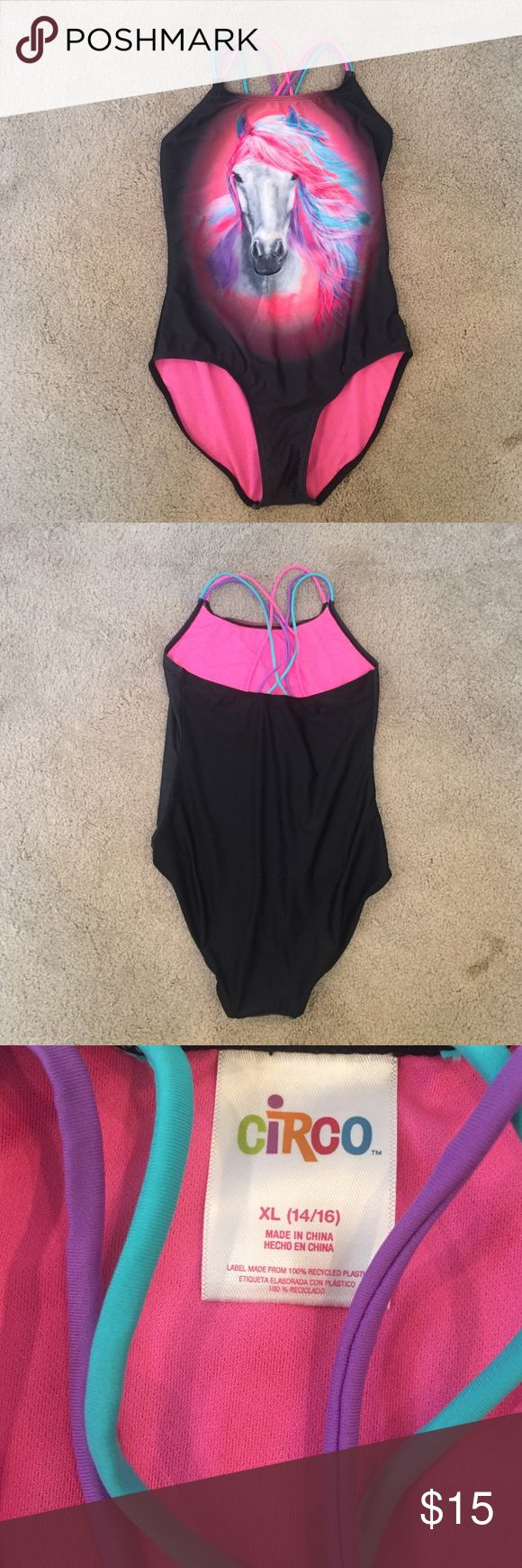 Unicorn One-Piece only worn once. size is a girls XL, but it fits me perfectly. i'm 5'2, 130 pounds. fits like an adult small/medium one piece would. Circo Swim One Pieces