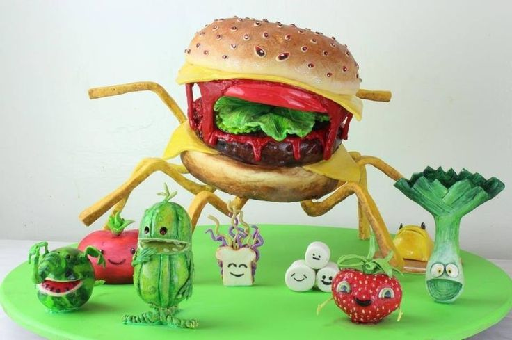 Cloudy with a chance of meatballs 2 cake. Freestanding cheeseburger spider, covered in modeling chocolate. Modeling chocolate hand painted figures.